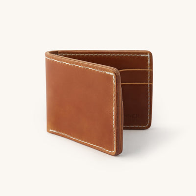 A leather bifold wallet with a couple card slots.