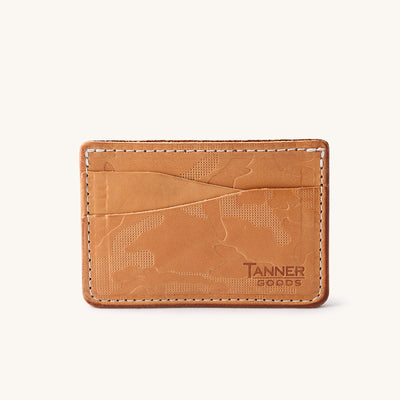 Tan leather wallet with texture and a Tanner Goods monogram in bottom right corner.