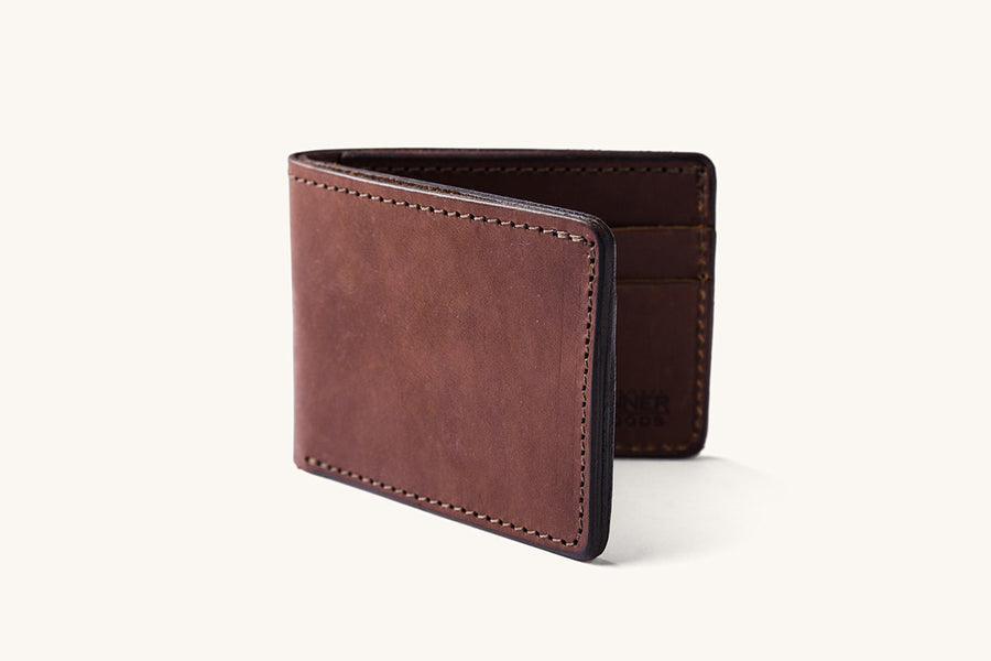A brown leather bifold wallet.