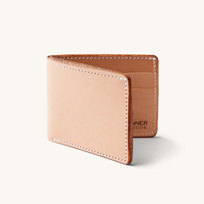 Bifold leather wallet with a natural finish.