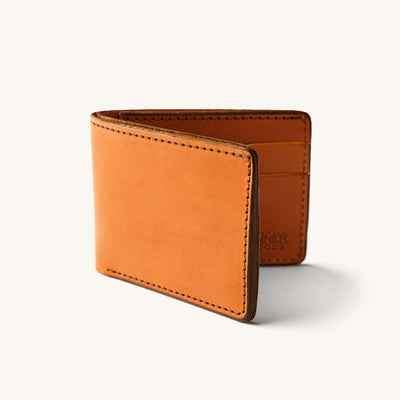A bifold wallet in light brown leather.