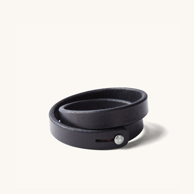 A double wrap black leather wristband with metal closure.