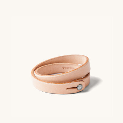 A double wrap natural leather wristband with metal closure.