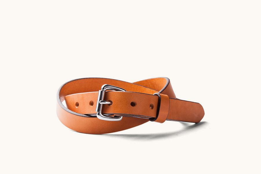 a saddle tan leather belt with stainless roller buckle