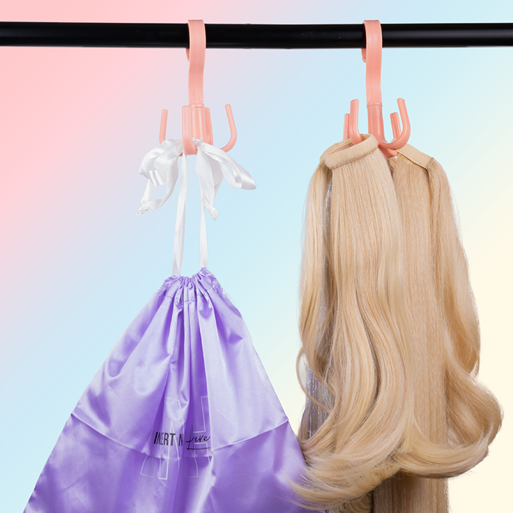 hangers with INH silk bag and hair hanging on them