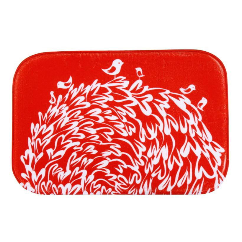 Red bird and tree illustration bath mat