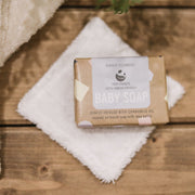 Cosy Cottage Soap Cosy Cuddles Baby Soap on a wooden bench