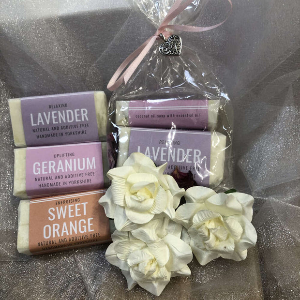fragranced travel soap set with white flower petals