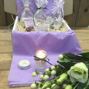 handmade candle burning in front of handmade wedding gift box