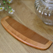 natural bamboo hair comb on a wooden table