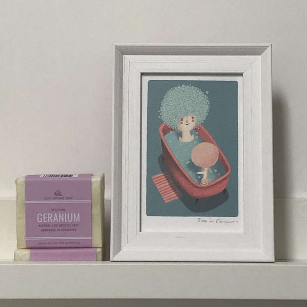 cooperillo framed picture next to a natural geranium soap bar