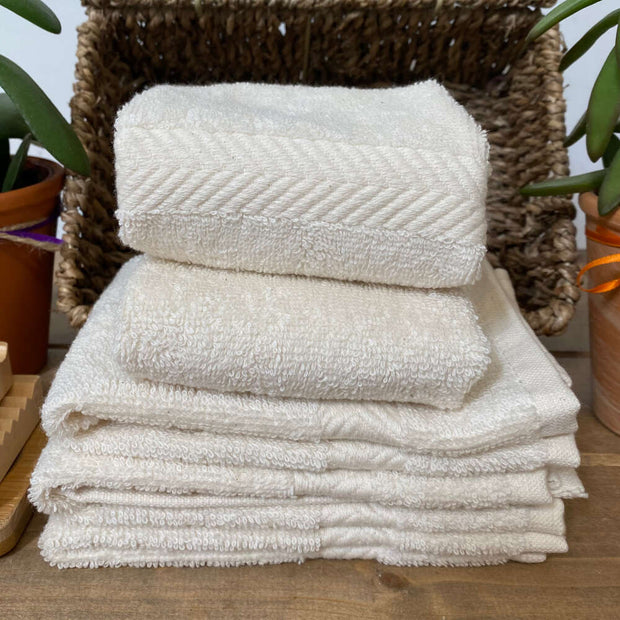 unbleached cotton face cloths stacked in a basket