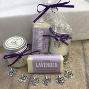 lavender travel soap and soy wax candle in biodegradable packaging bundle with purple ribbon