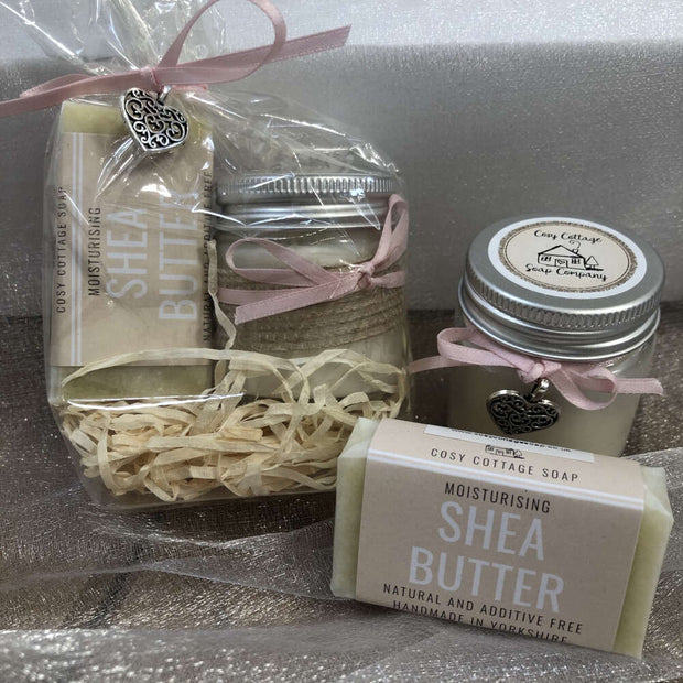 moisturising shea butter travel soap and soy wax candle with bundle in biodegradable packing with pink ribbon