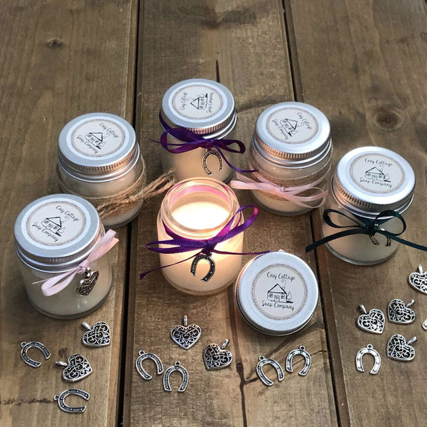 natural soy wax candles in a semi circle with one lit candle in the middle