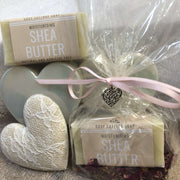moisturising shea butter travel soap and purple petals in biodegradable packaging with pink ribbon and love hearts