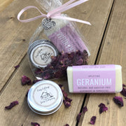 geranium handmade travel soap bar with lip balm in biodegradable packaging with petals tied with a pink ribbon