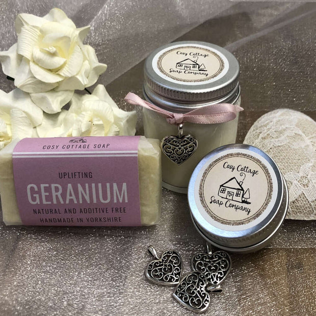uplifting geranium travel soap, soy wax candle and lip balm with love heart pendants