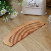 bamboo hair comb on wooden bench