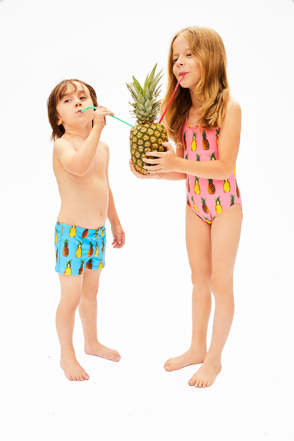 aqua and pink pineapple print swimsuits for kids, made in Canada by Bathing Belle Swimwear