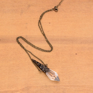 Retro Bronze Bullet Clear Crystal Glass Hollow Pendant