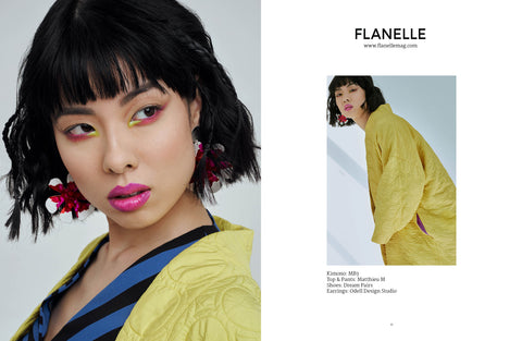 Large Silver Flower Dangle Earrings and Gold Horseshoe Earrings published in fashion editorial for Flanelle Magazine