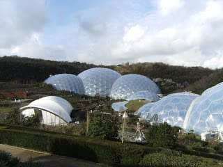 a large white building with Eden Project in the background