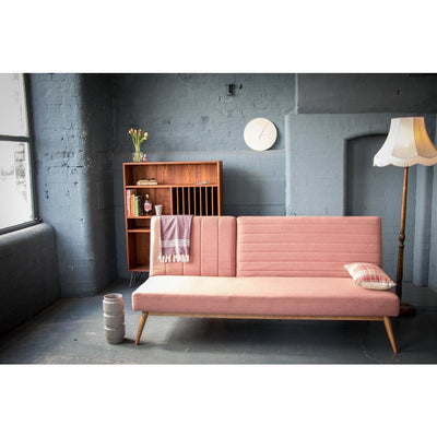 Large snooze multifunction sofa bed in dusky pink by Calvers & Suvdal
