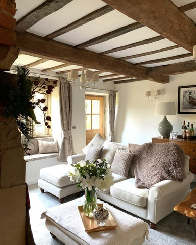 beautiful country cottage living room with wood beams