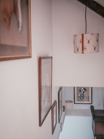 country paintings in hallway