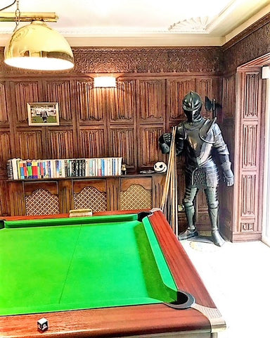suit of armour in wood panelled billiard room