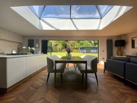 beautiful lounge kitchen diner with glass cupola and large bifold doors
