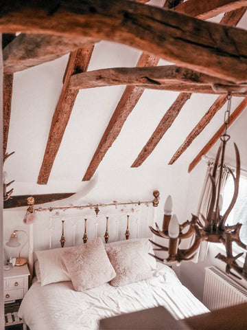 country bedroom with vaulted ceiling with beams