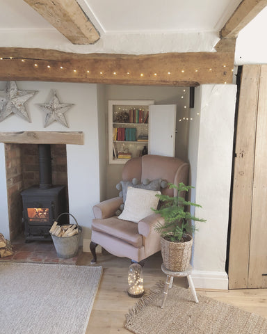 cosy rustic cottage living room with beams and log burner