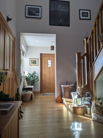 modern country style hallway entrance with wooden staircase