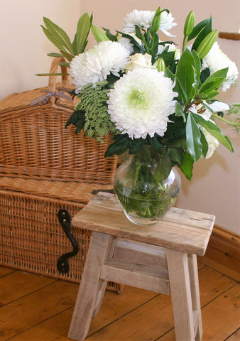 white flowers on milking stool