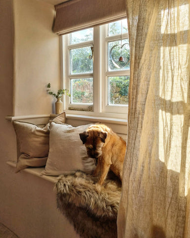 window seat rustic natural tones and cushions