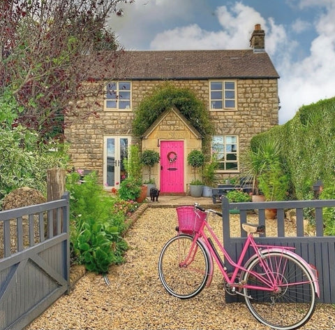 Cotswold stone country cottage with pink front door