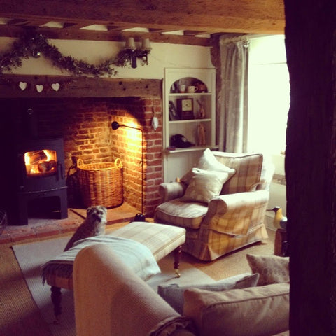 log burner in snug country cottage room