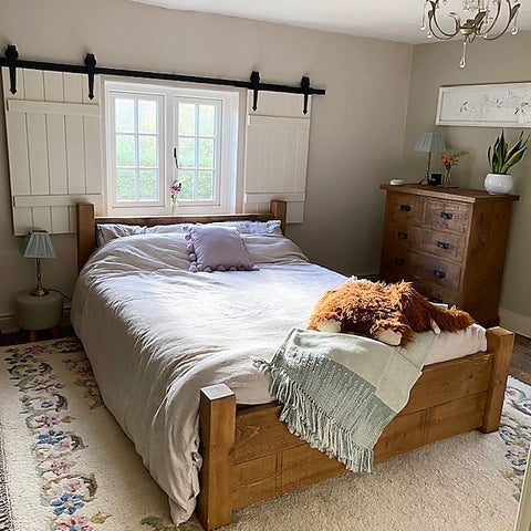 country cottage bedroom with window shutters