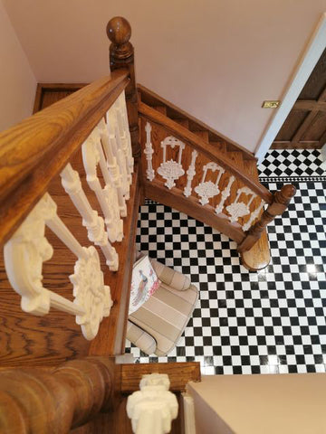wood and cast iron spindle staircase in hallway