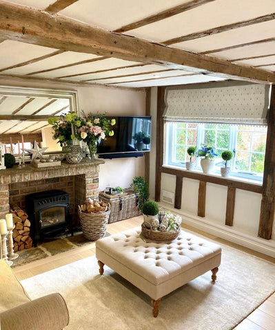 country style living room with wooden beams