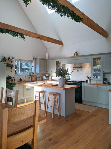 country kitchen with vaulted wooden beam ceiling and Rayburn