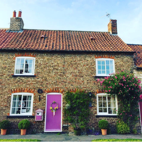 Country cottage with pink front door