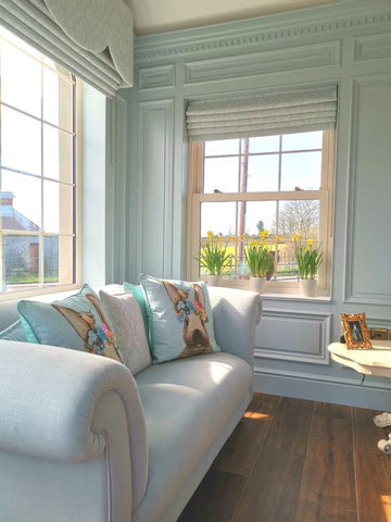 sunroom in blue hues with panelled walls inspired by Mrs Crawley's living room in Downton Abbey TV show