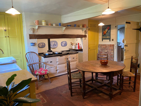 yellow country kitchen with Aga inspo Wealden Hall House interior