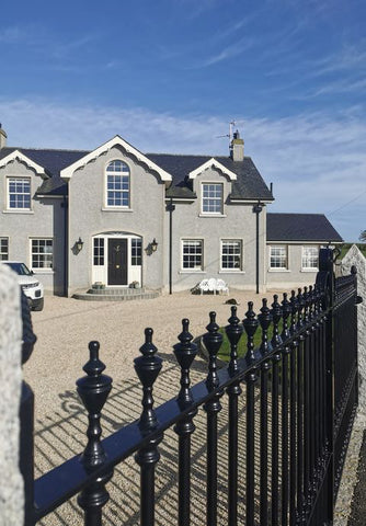 self build georgian style house exterior in grey with period railings and coach lamps