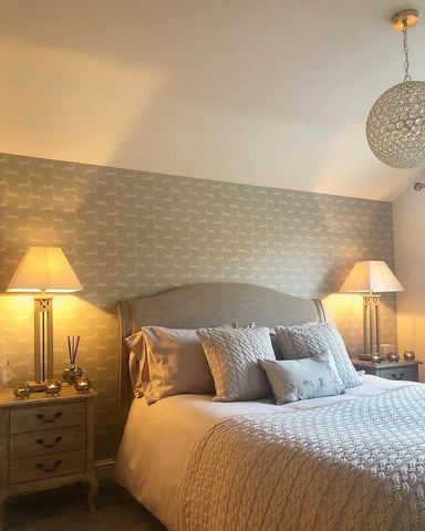 country bedroom with stag print wallpaper