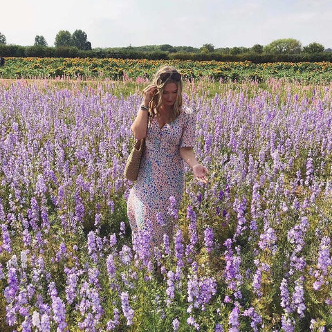 Sophie in a country field of flowers