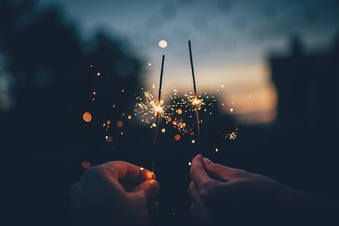 holding sparklers on bonfire night